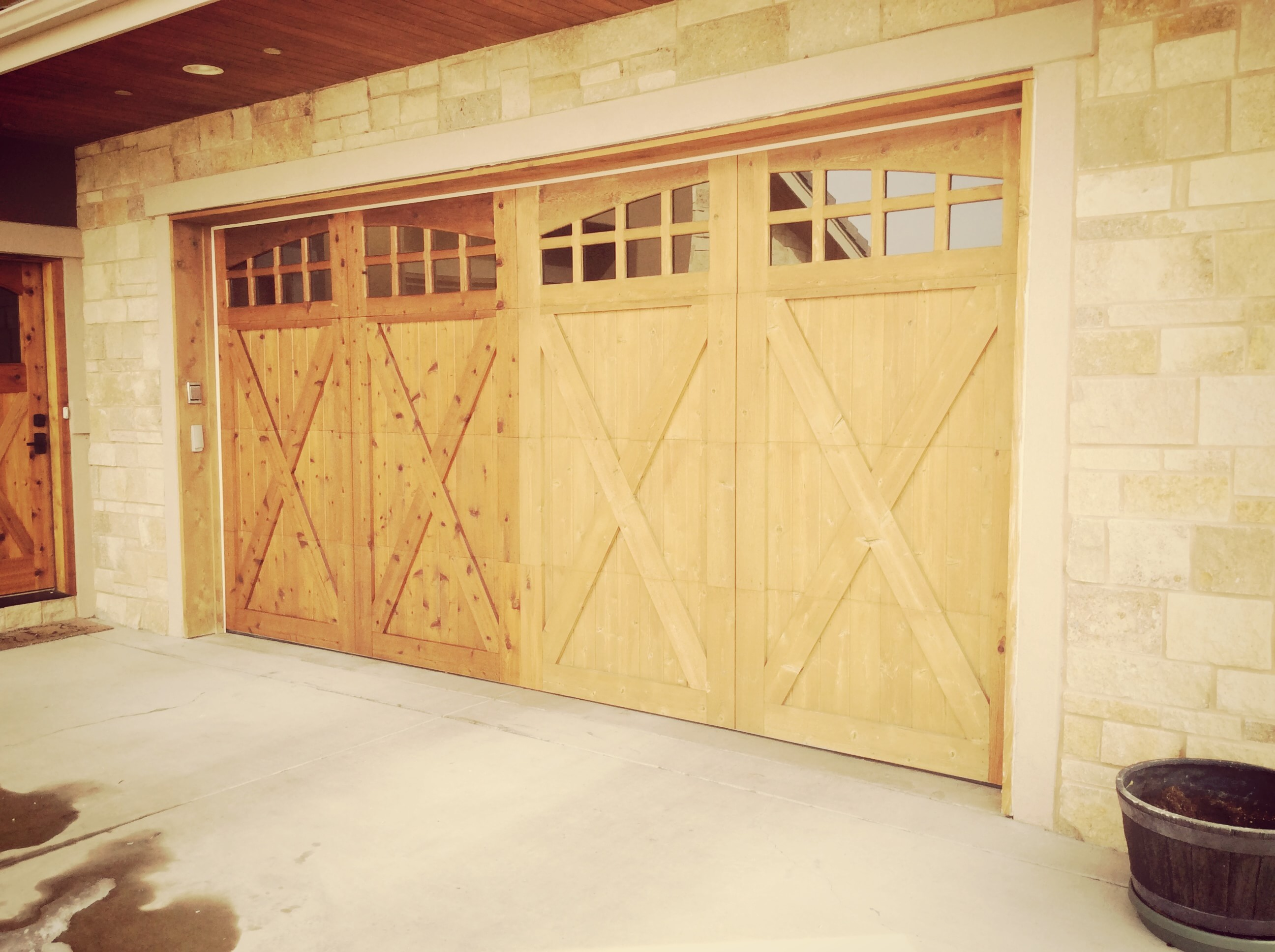 cedar design knotty portfolio trim garage door arched avada wood doors with